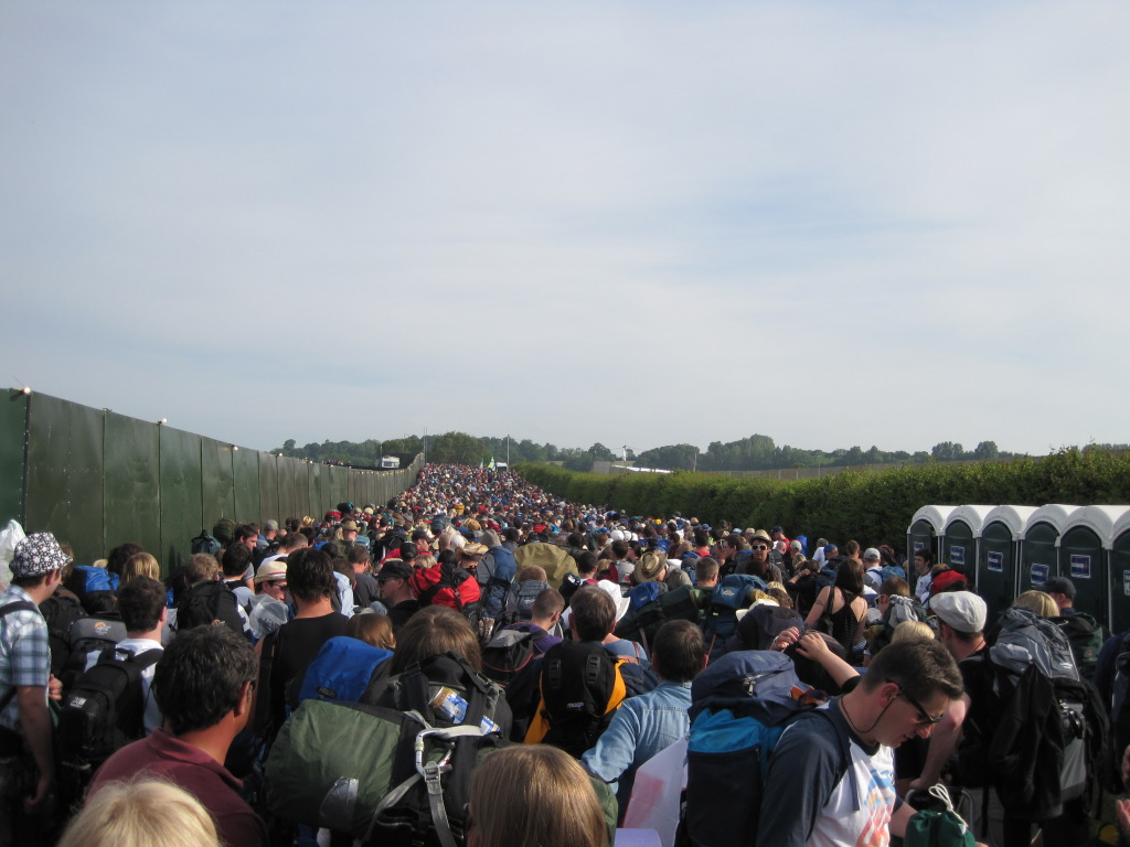 Crowds before gates open at Glastonbury queues to enter long toilet queue