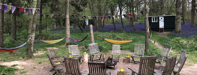 The gorgeous fire pit area at the Green Escape glamping woodland