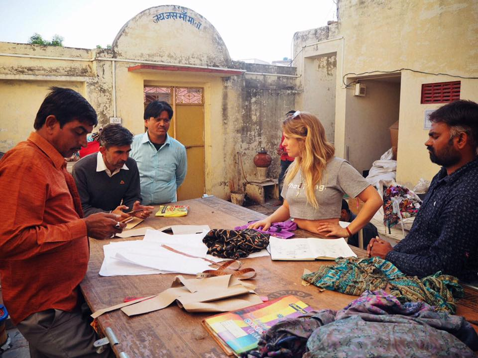 Dulcie in Pushkar with her local tailors sorting through sari fabrics - festival wear from Dulcie's Feathers