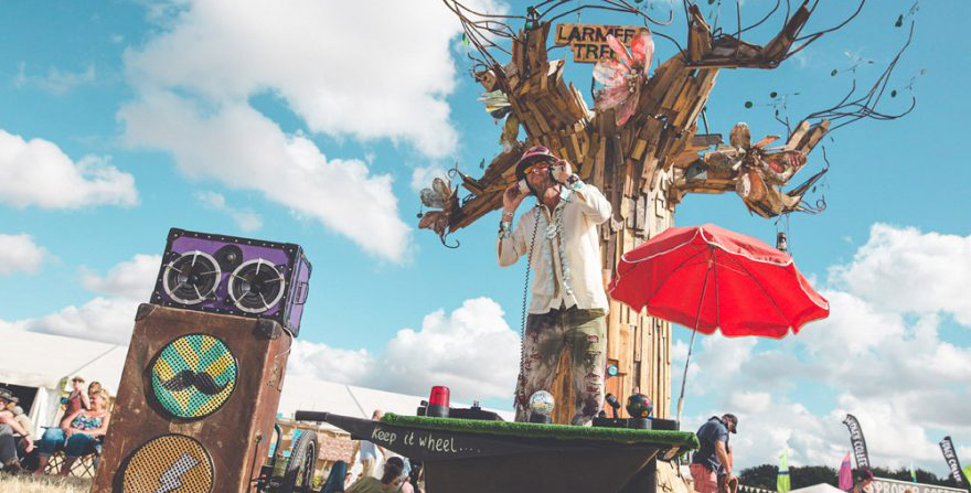 "Larmer Tree festival - awesome mobile DJ in front of ""The Larmer Tree"" actual tree"