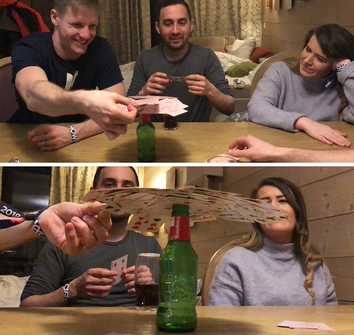 Us in our apartment playing card games, balancing cards on top of an empty beer bottle