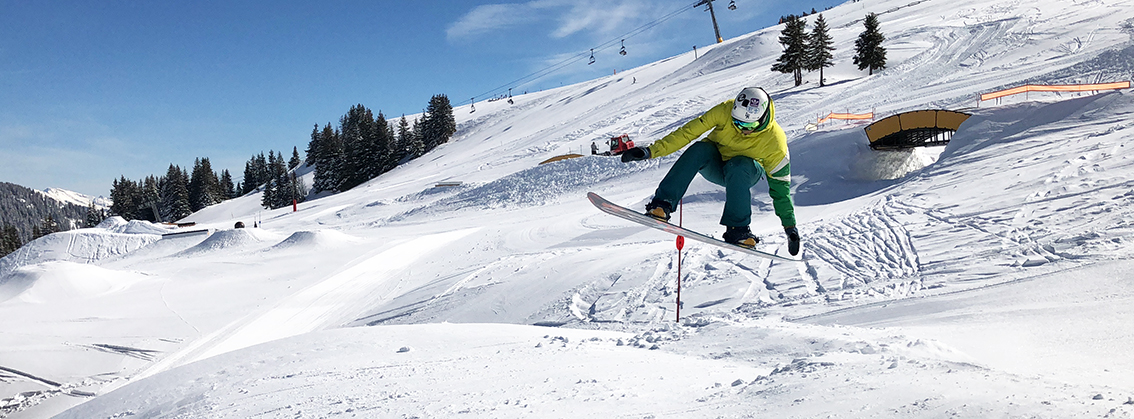 Stafford looking pretty good in his bright green jacket doing a grab on a jump in the Swiss snowpark