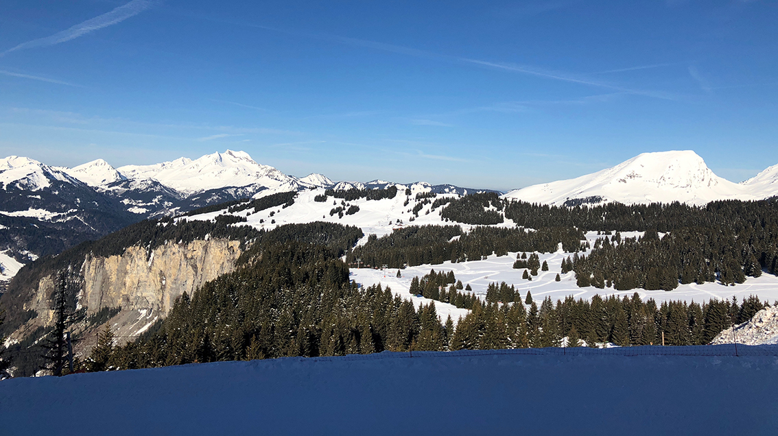 The gorgeous view from our Snowboxx apartment balcony over the Morzine valley