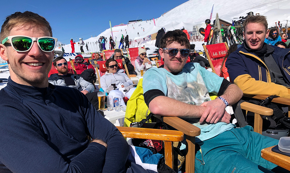 Andy, Ell and Stafford at Le Yeti on the sun terrace for lunch with blue skies behind