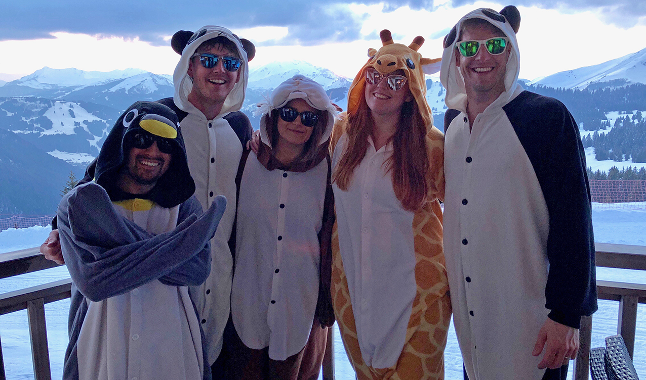Wearing our Kigus (animal onesies) and sunglasses on our apartment balcony on our final night at Snowboxx 2018