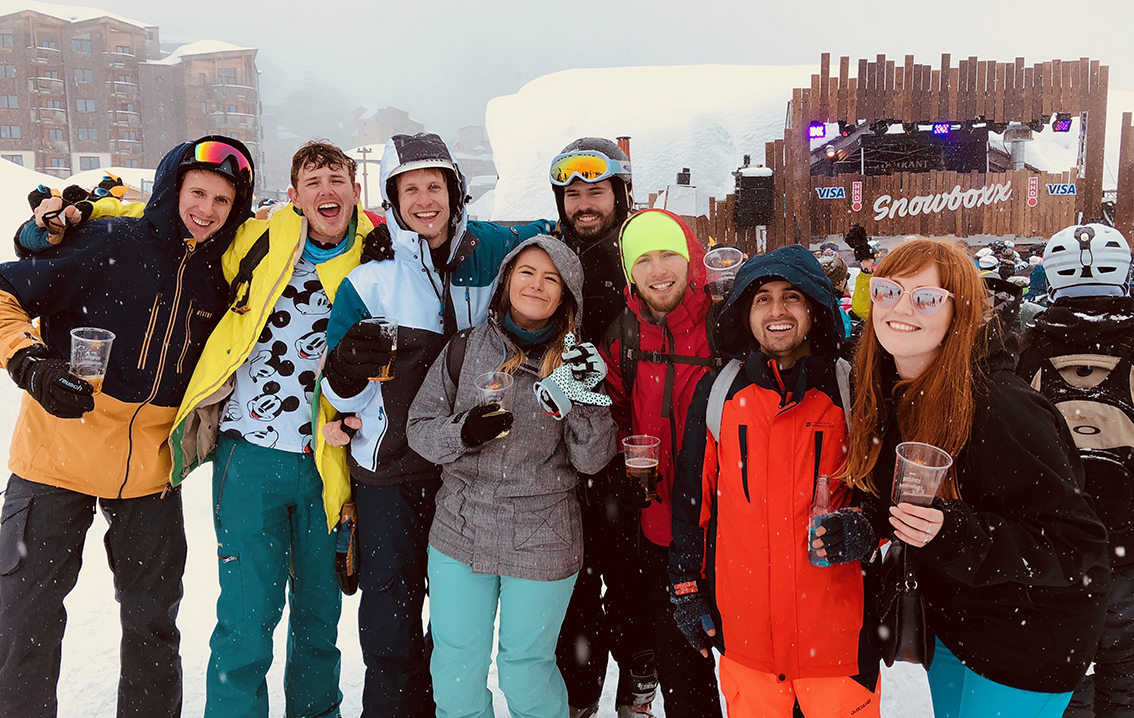 All of my gang in our ski gear holding beers in front of the Apres stage at Snowboxx festival, big smiles all round!
