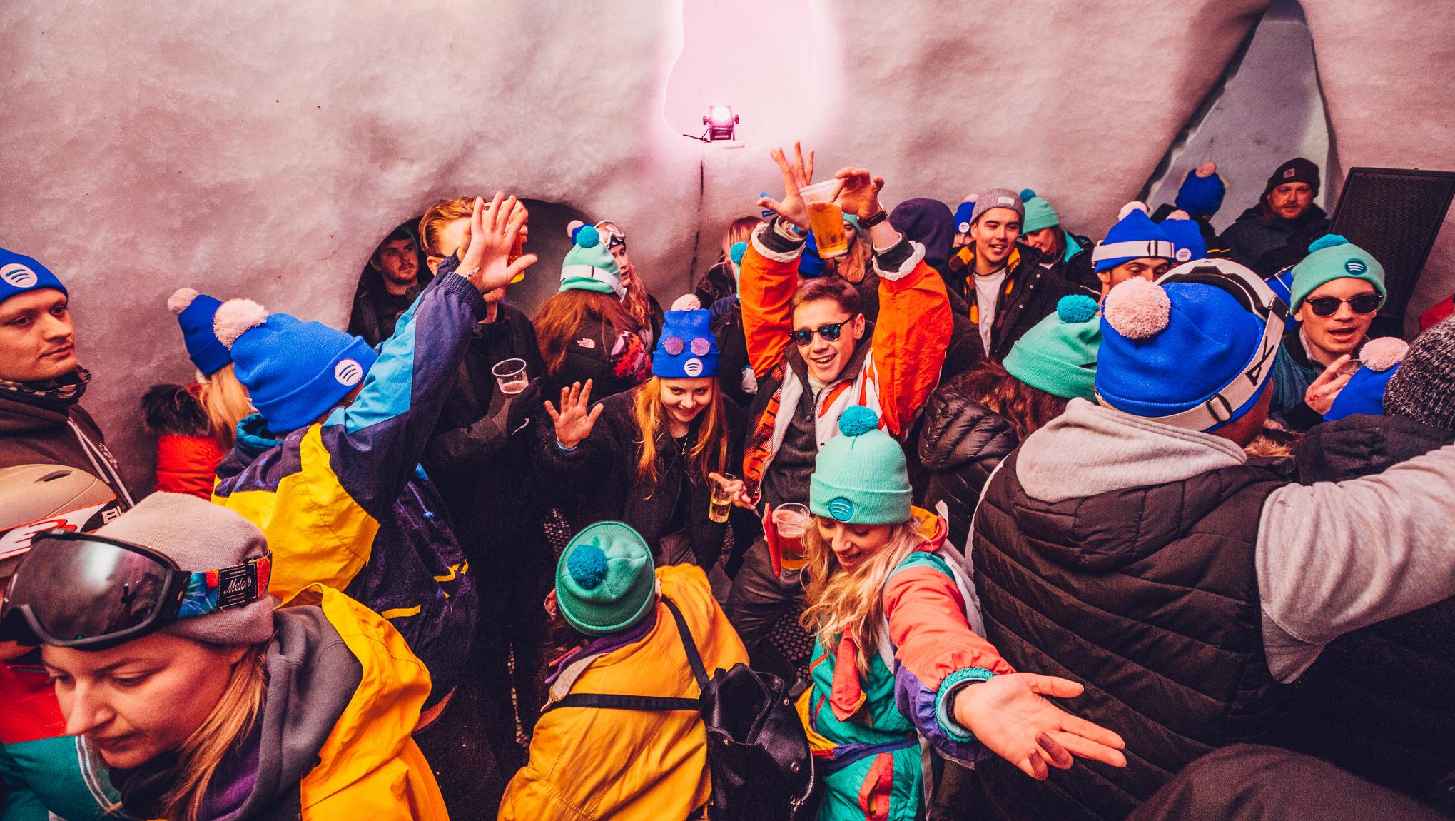 Igloo party ravers in retro ski gear