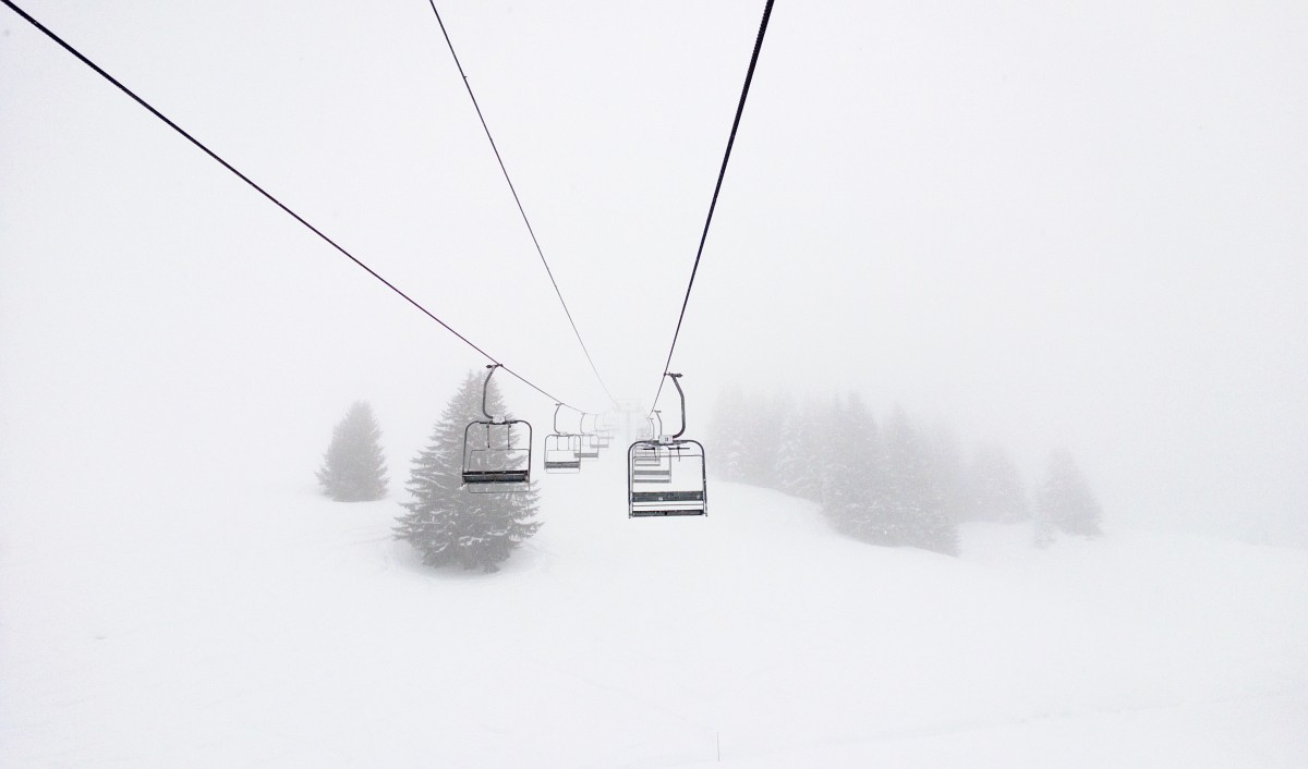The view from the chairlift into whiteness of the cloud, eery photo. Snowboxx ski festival, Avoriaz