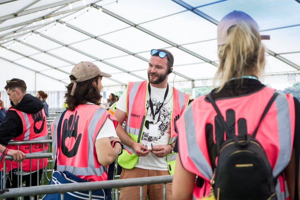 MyCause manager Robin W in his supervisor tabard at the wrist banding gates of Love Saves the Day festival