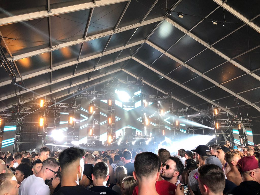 The view of the Terminal 1 stage inside an airplane hangar for Hannah Wants