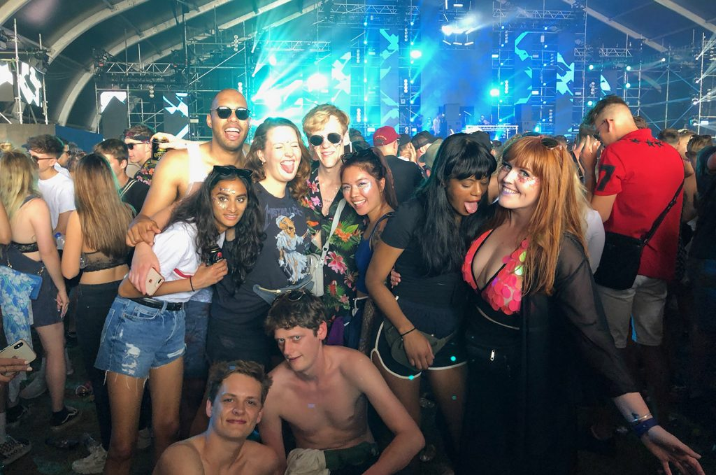 Another group photo of my sparkly friends and I at the Terminal 1 stage at We Are Festival with lots of blue laser lights