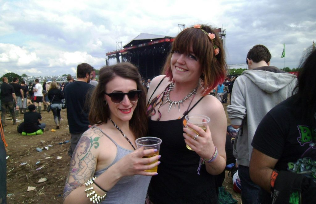 Me in 2012 with my friend stood in front of the main stage at Download Festival holding beers