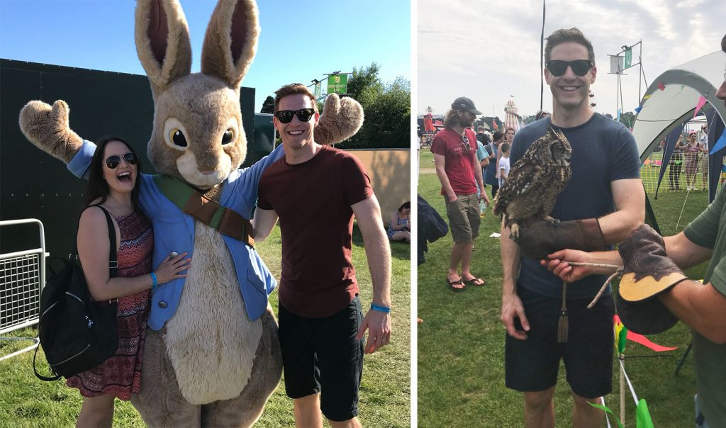 Andy and Zoe standing with a huge Peter Rabbit, and Andy holding a beautiful owl