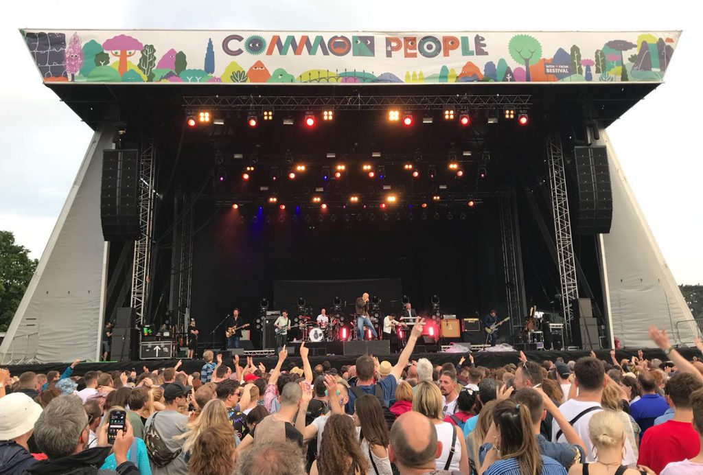 The Common Stage looking glorious with a big crowd with hands in the air