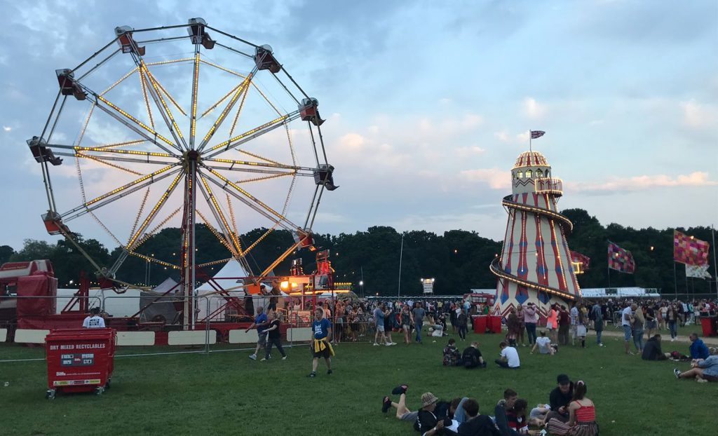 The Ferris wheel and Helter Skelter at dusk at Common People festival