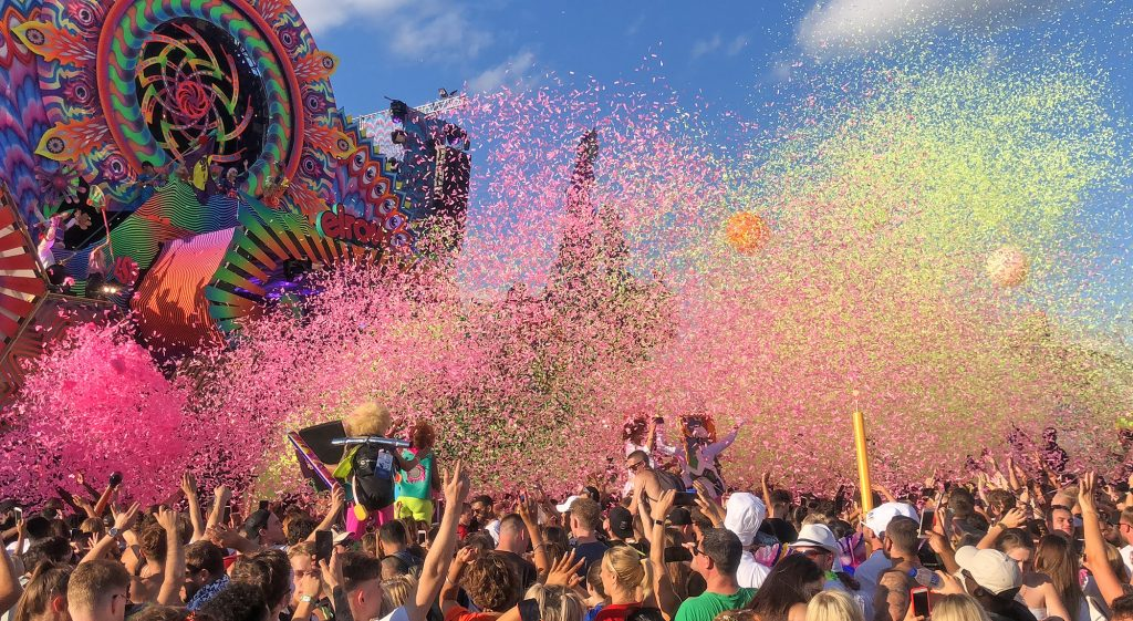 Pink and yellow confetti has been fired out of the main stage cannons over the crowd going wild at Elrow Town